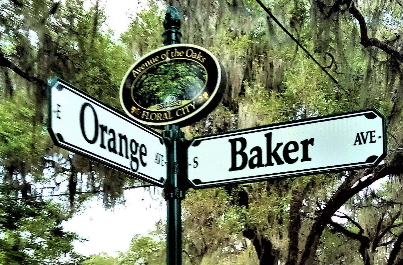 street signs at corner of Baker St and Orange Ave
